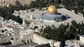 Israelis injured in gun attack near Jerusalem holy site